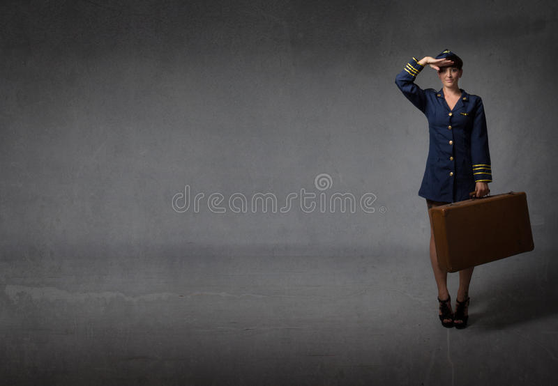 Air captain in a military saluting. Dark nackground royalty free stock images