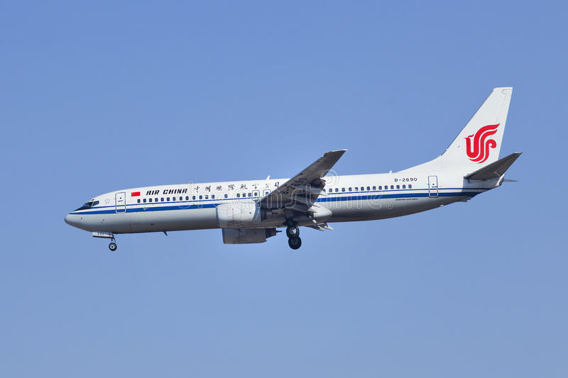 Air China B-2690, Boeing 737-800 landing in Beijing, China. BEIJING–MARCH 6, 2014. B-2690 Boeiing 737-800 landing on Beijing Capital Airport. The airplane stock images