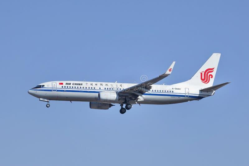 Air China B-5682, Boeing 737-800 landing in beijing, China. BEIJING–MARCH 6, 2014. B-5682 Boeiing 737-800 landing on Beijing Capital Airport. The airplane royalty free stock image