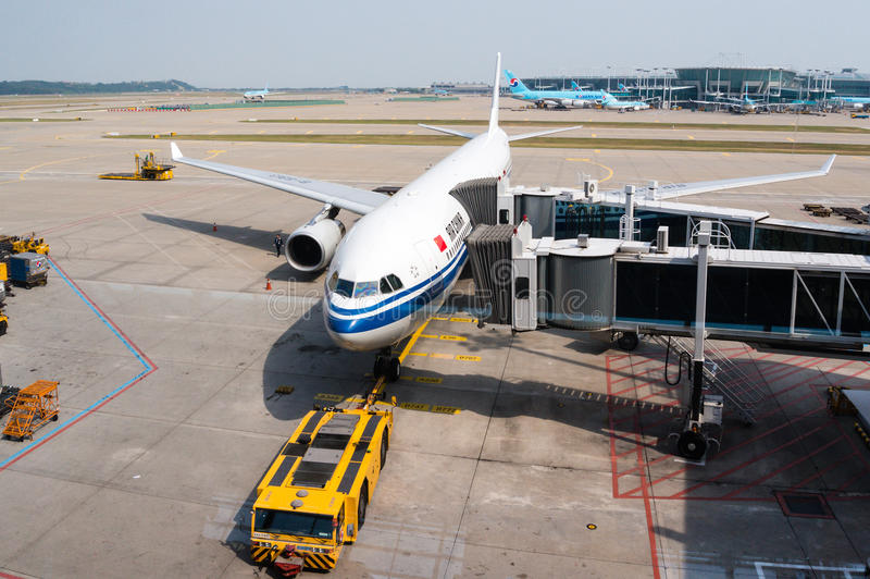Air China Plane on Ariport Tarmac. An Air China Airlines plane being serviced on the tarmac of Tokyo Narita Airport. Headquartered in Beijing, the airline is royalty free stock photo