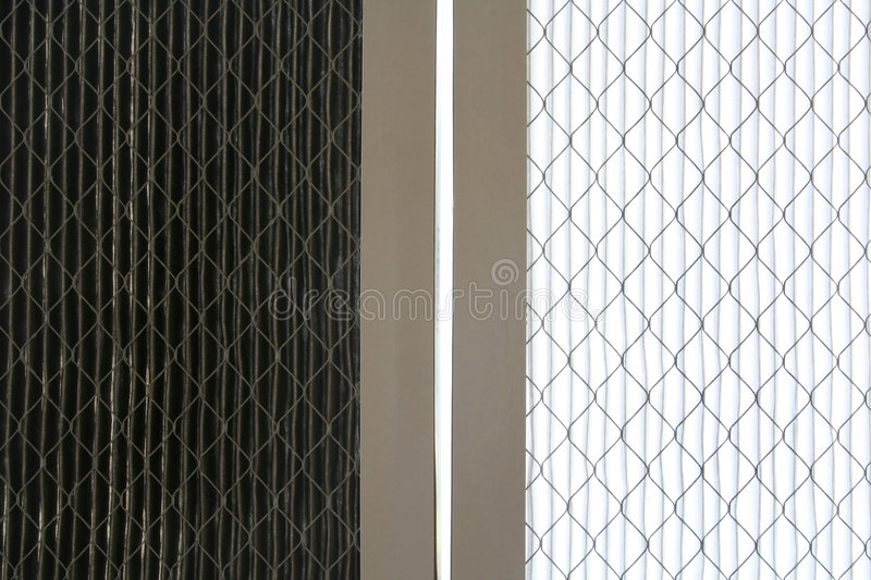 Air cleaning filters. Clean and dirty air filters stock photography