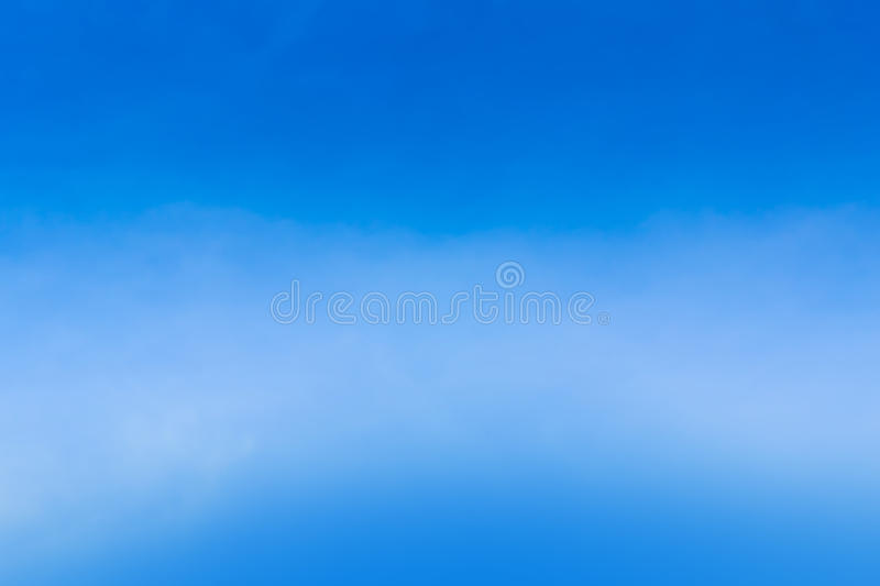 Air clouds in the blue sky. The sky with the clouds moving in the wind is a small group of clouds stock photo