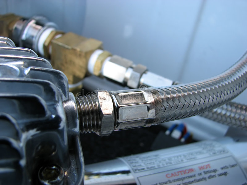 Air Compressor Parts. Close up view of the mechanical parts of an air compressor stock images