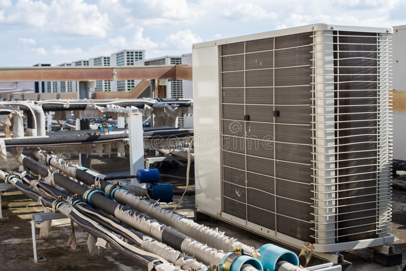 Air compressors on roof of factory stock photography