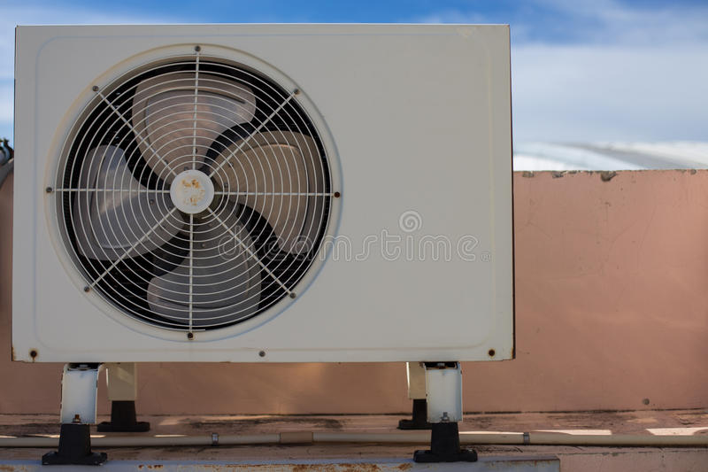 Air compressors on roof of factory royalty free stock photos