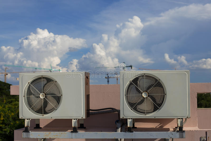 Air compressors on roof of factory royalty free stock images