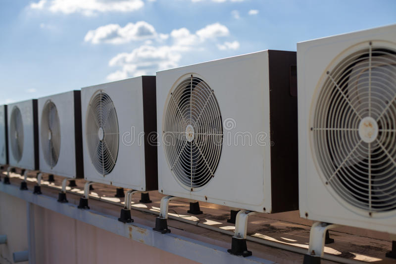 Air compressors on roof of factory royalty free stock photography