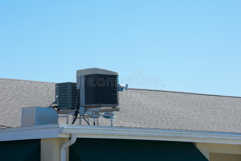 Air conditioner A/C unit on rooftop with a blue sky stock image