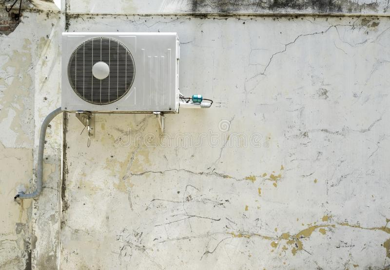 Air conditioner compressor installed in white wall building stock photos