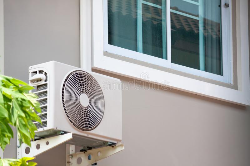 Air conditioner compressor outdoor unit insta. Lled outside the new house stock photo