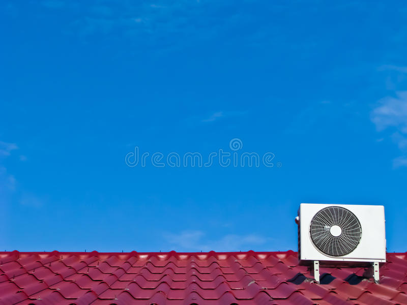 Air Conditioner Compressor On The Red Roof Stock Images