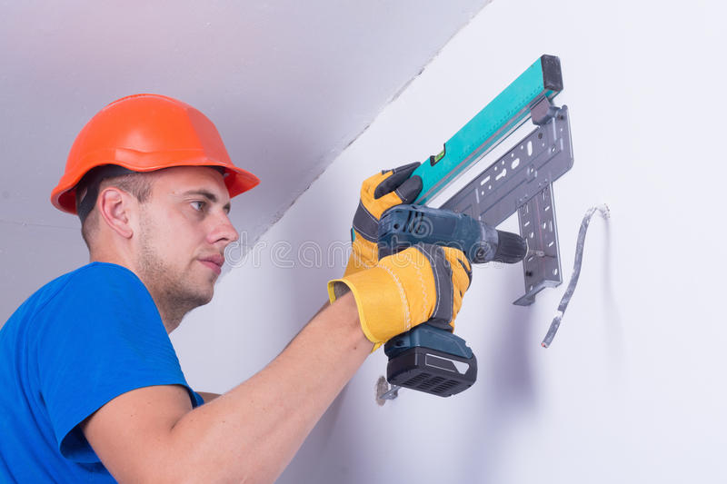 Air conditioner. Air conditioning master preparing to install new air conditioner stock images