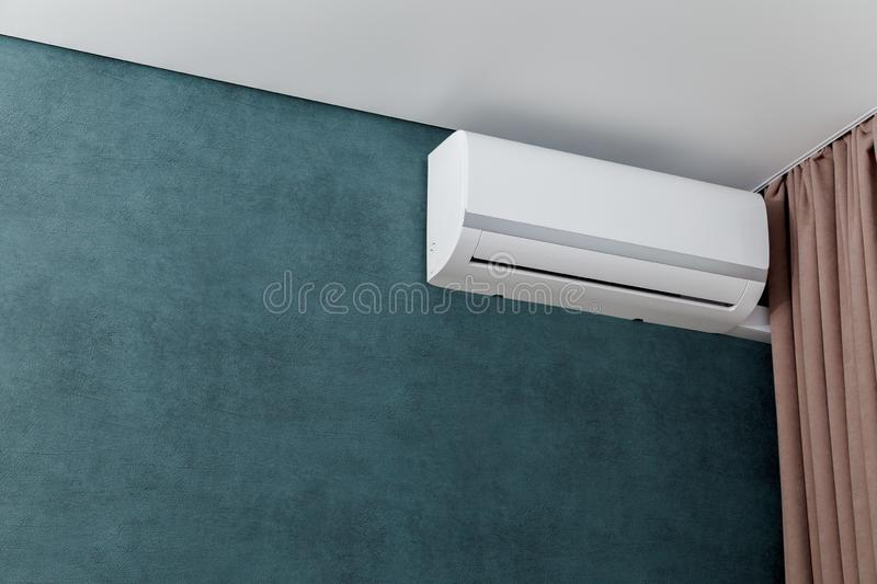 Air conditioner on green wall, shallow dept of field stock image