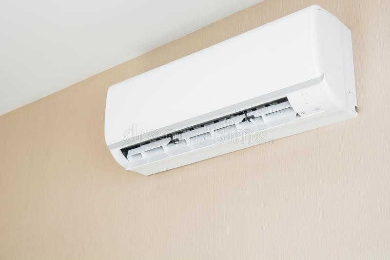 Air conditioner hanging on the wall stock image