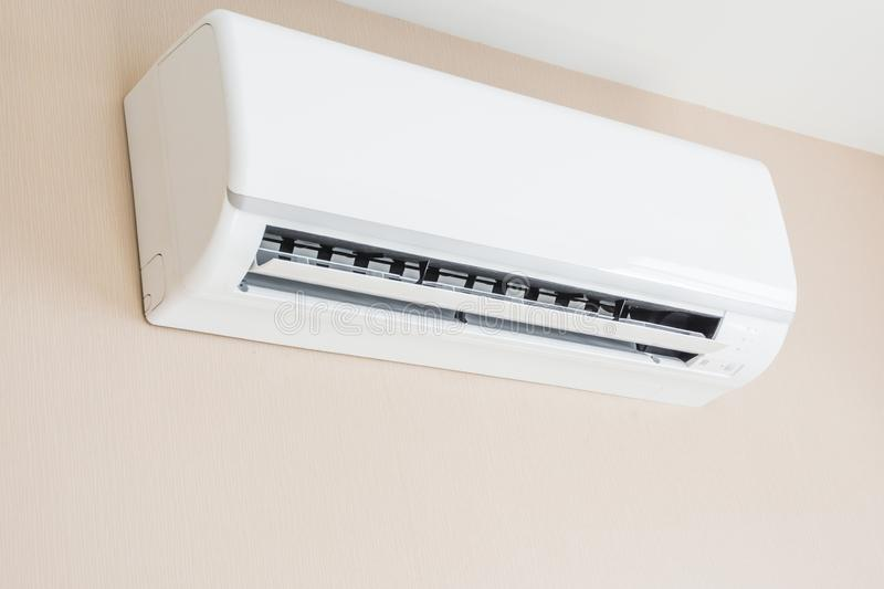 Air conditioner hanging on the wall stock photography