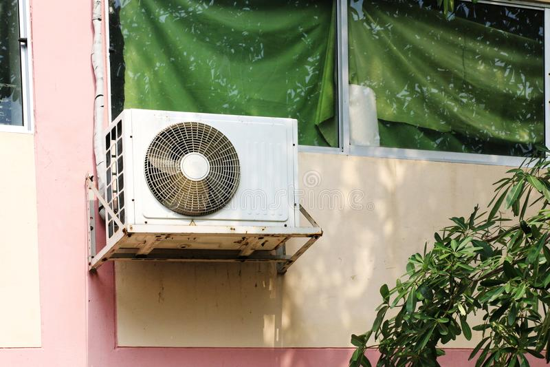 Air conditioner mounted outside the building office. The Air conditioner mounted outside the building office stock photos