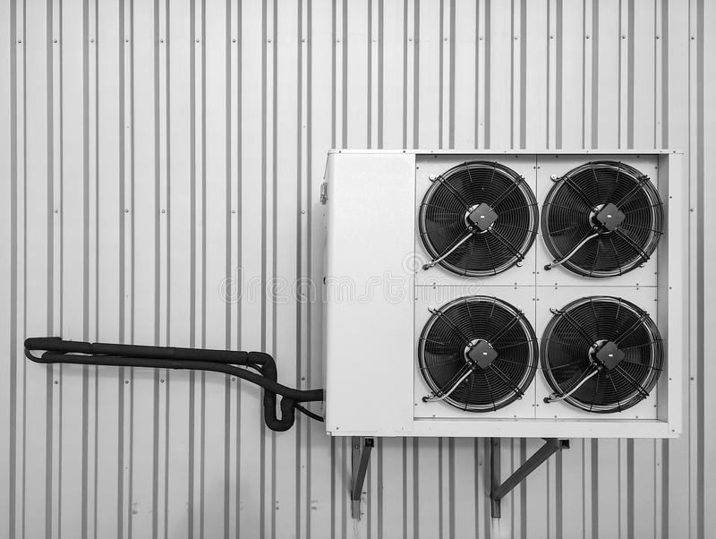 Air conditioner system on enterprise roof, cooling system, black and white tone royalty free stock images