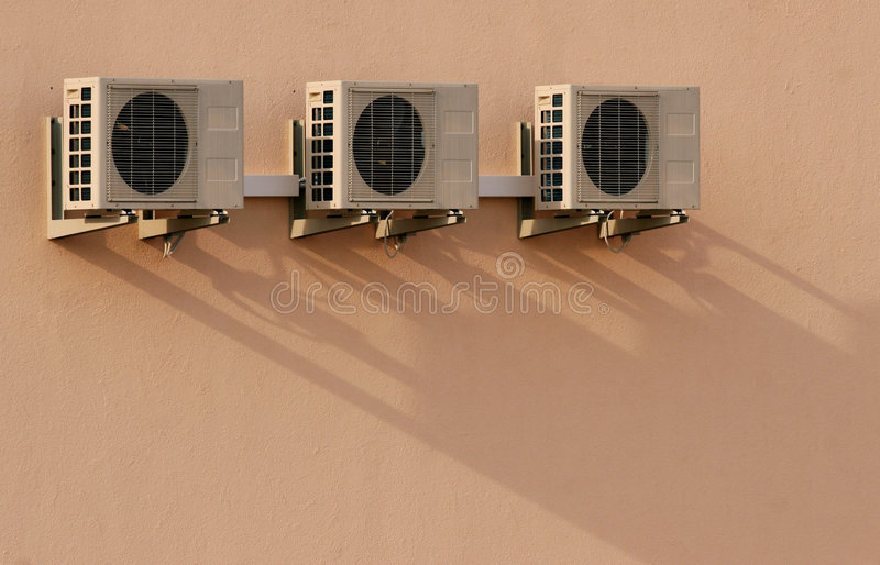 Air conditioner2. Three air conditioners on the wall with shadow stock photos
