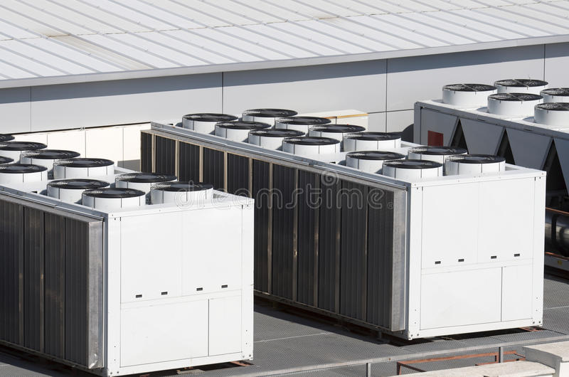 Air conditioning. View on the roof of a building of a large air conditioning equipment stock photo