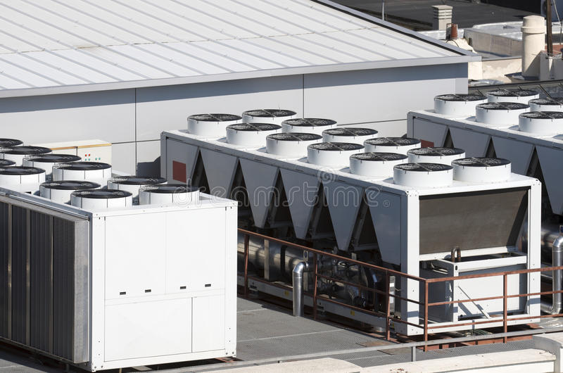 Air conditioning. View on the roof of a building of a large air conditioning equipment stock images