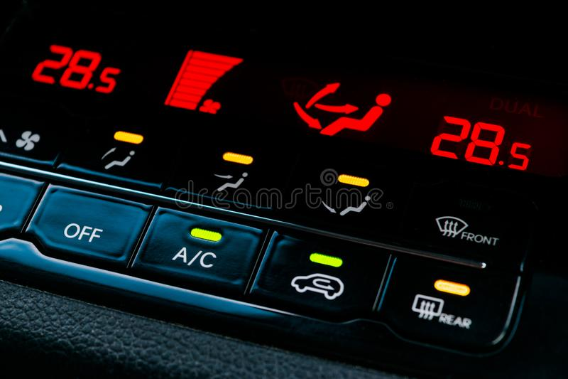 Air conditioning button inside a car. Climate control AC unit in the new car. Modern car interior details. Air conditioning button inside a car. Climate control royalty free stock photography