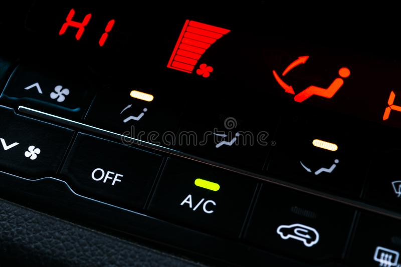 Air conditioning button inside a car. Climate control AC unit in the new car. Modern car interior details. Air conditioning button inside a car. Climate control royalty free stock photos