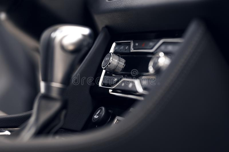 Air conditioning button inside a car. Climate control unit in the new car. Modern car interior details royalty free stock photos