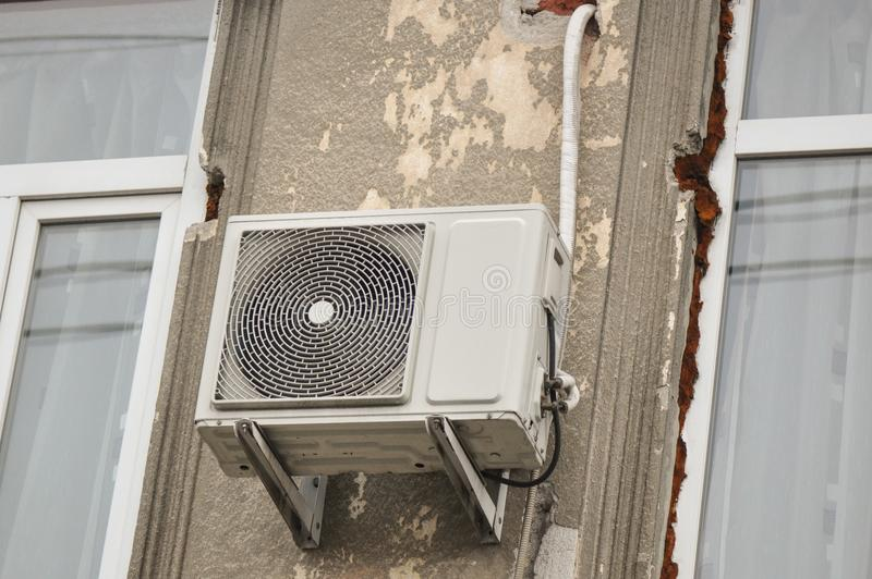 Exterior air conditioning unit on wall building. Air conditioning, exterior unit on the facade of the old building stock photo
