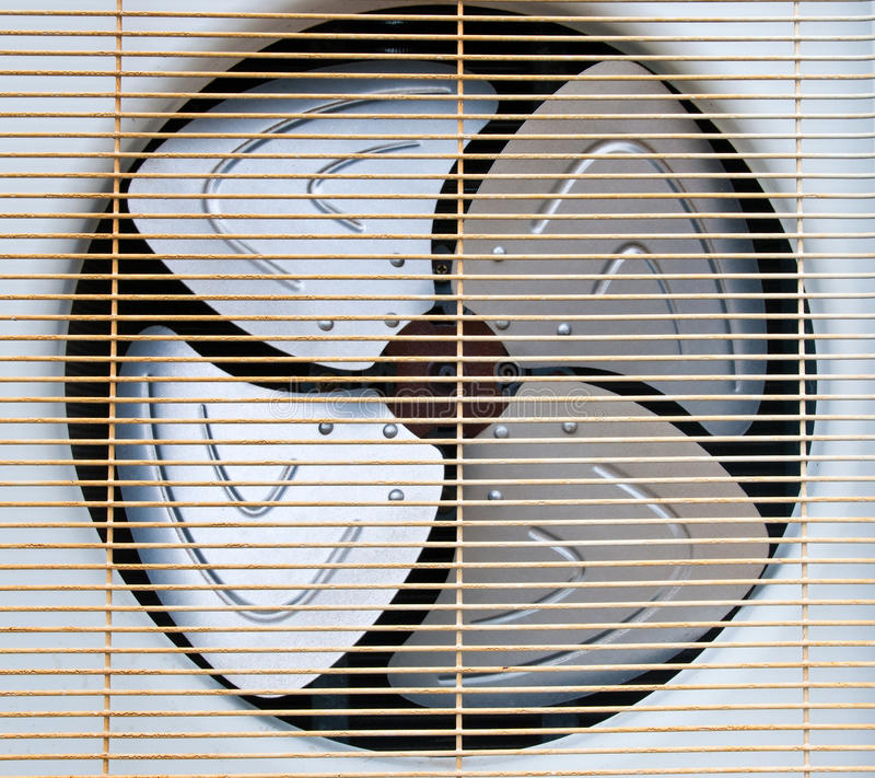 Air conditioning fan. Condenser fan air through the use of old rust royalty free stock photo