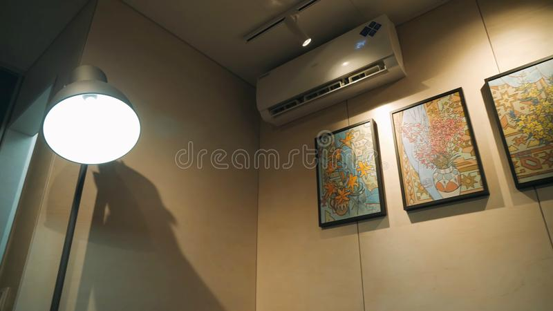 Air conditioning in a modern apartment in the bright Scandinavian style. stock photography