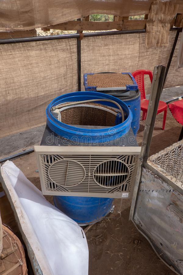 Air conditioning system made of waste materials from an old barrel, corrugated cardboard and a fan royalty free stock images