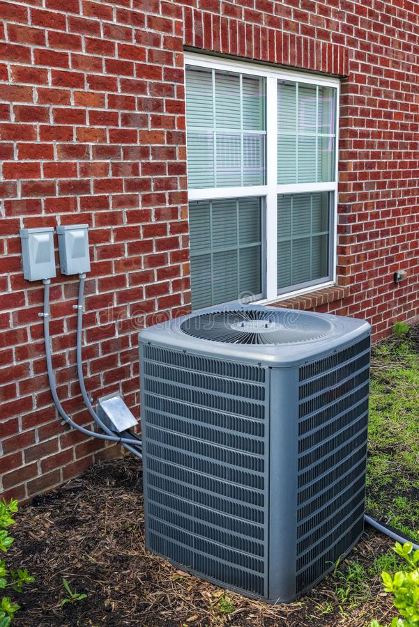 Air Conditioning Unit for Apartment Home. Vertical shot of an air conditioning unit for an apartment home stock photo