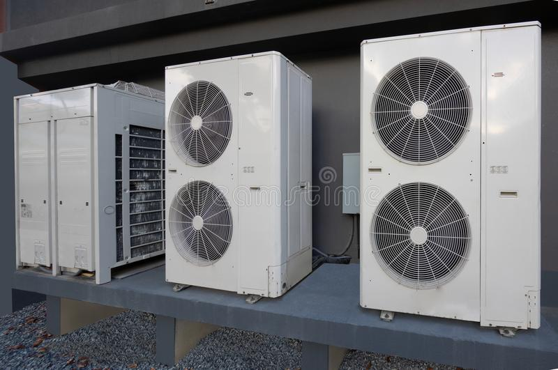 Air conditioning unit outside apartment house. High efficiency modern AC-heater unit, energy save solution-horizontal, outside an apartment royalty free stock photos