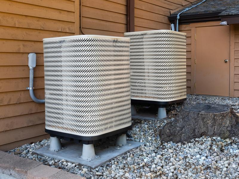 Air conditioning unit outside apartment house. High efficiency modern AC-heater unit, energy save solution-horizontal, outside an apartment royalty free stock images