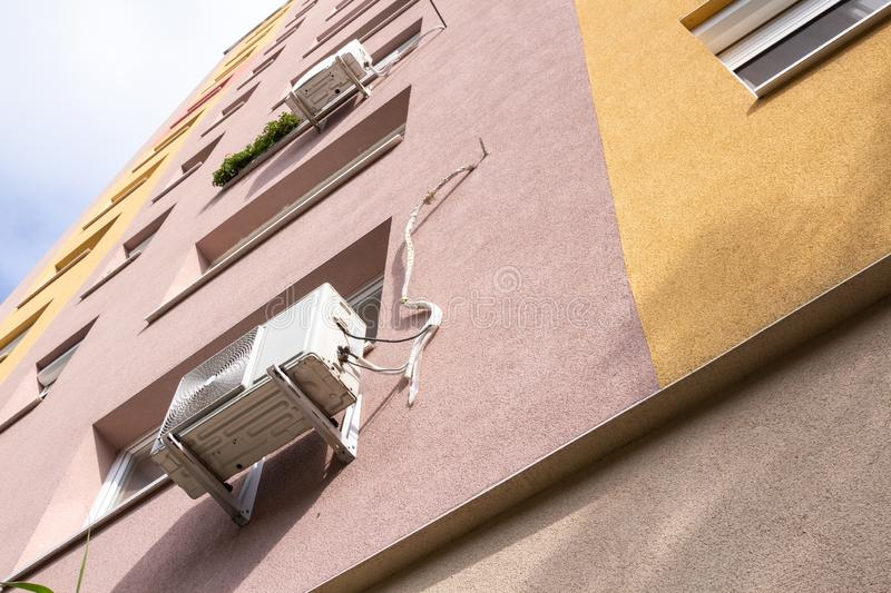 Air conditioning units outside block of flats royalty free stock images