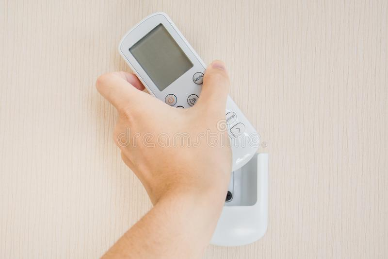 Air conditoner remote control hanging on the wall royalty free stock photo