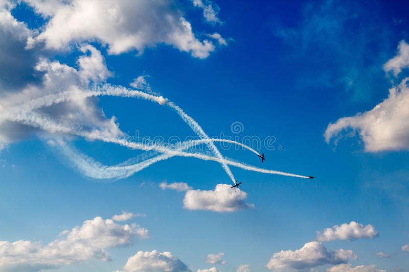 Flying In Formation. Air dogfight at airshowv- with smoke Aerobatic stunt stock image