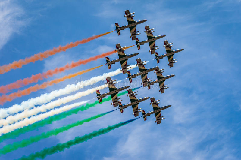Air exhibition. The italian acrobatic jet squad named frecce tricolori doing tricks in the sky royalty free stock photo