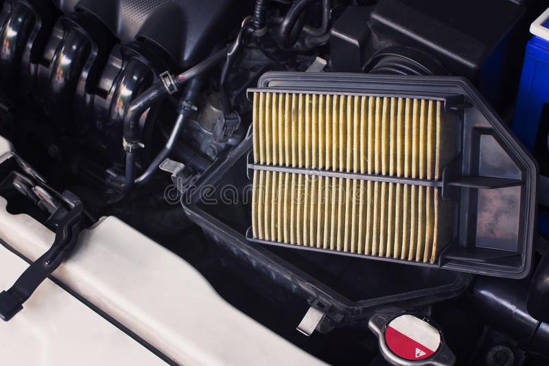 Air filter, The old dirty air filter makes the air flowing through the intake manifold in the engine car less. royalty free stock photo