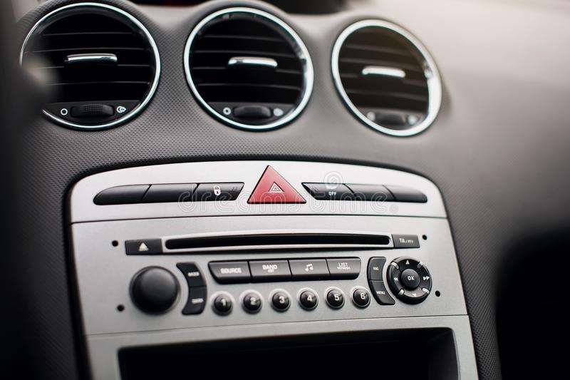 The air flow inside the car. Detail audio system buttons in car. royalty free stock photography