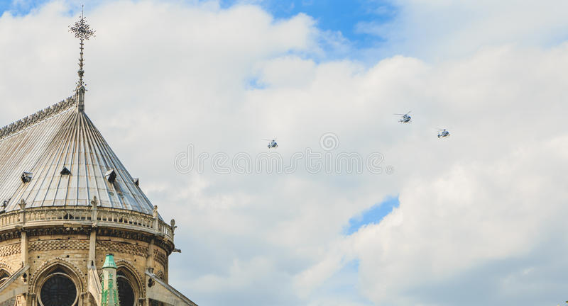 Air Force helicopters fly over the Notre-Dame Cathedral in Paris royalty free stock image