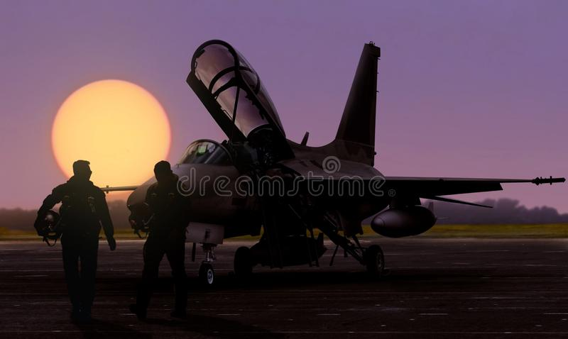 Air force jet fighter pilots silhoutte at sunset on military base airfield stock image