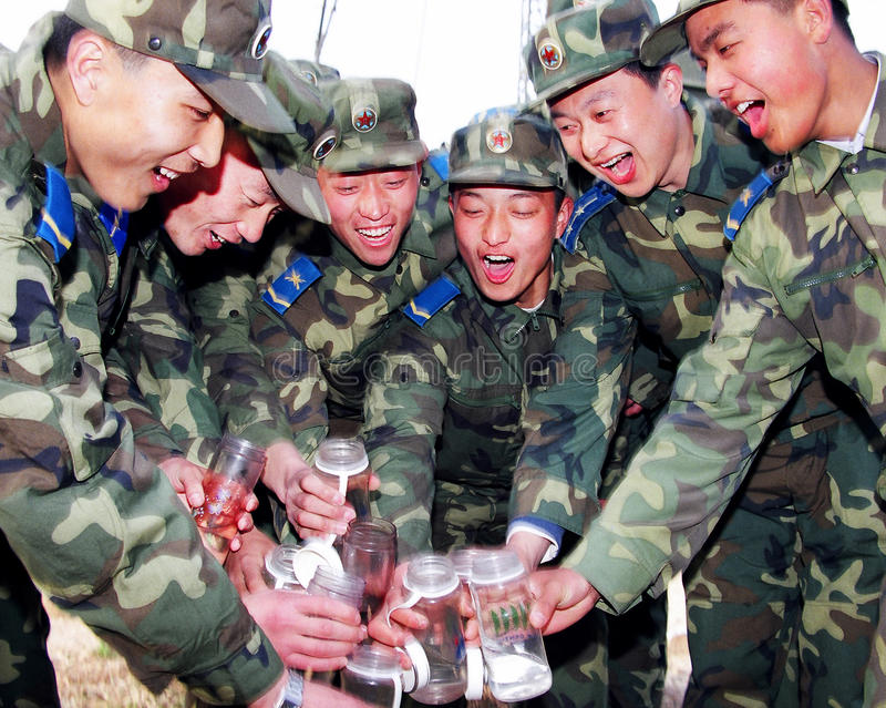 Air force soldiers cried out, the room for drink in the first place. The people's liberation army soldiers, happy, smile, teeth, slogans, clink royalty free stock image