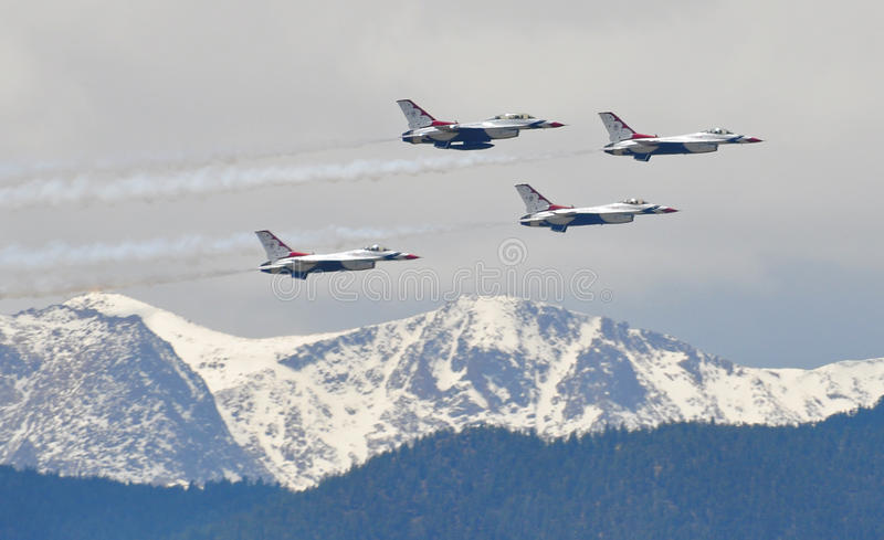 Air Force Thunderbirds Fly over Snow Capped Rocky stock image