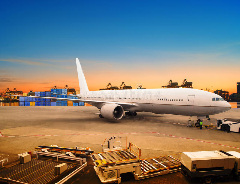Air freight and cargo plane loading trading goods in airport con. Tainer parking lot use for shipping and air transport logistic industry stock photo