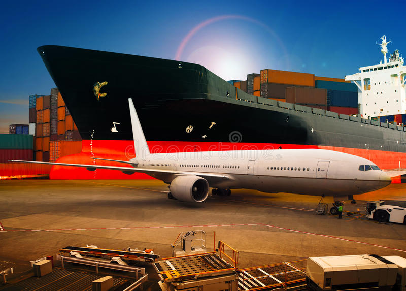 Air freight ,cargo plane loading trading goods in airport container parking lot use for shipping and air transport logistic indus. Try against shipping port royalty free stock image