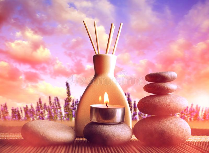 Air freshener with candle and zen pebbles at sunset. royalty free stock images
