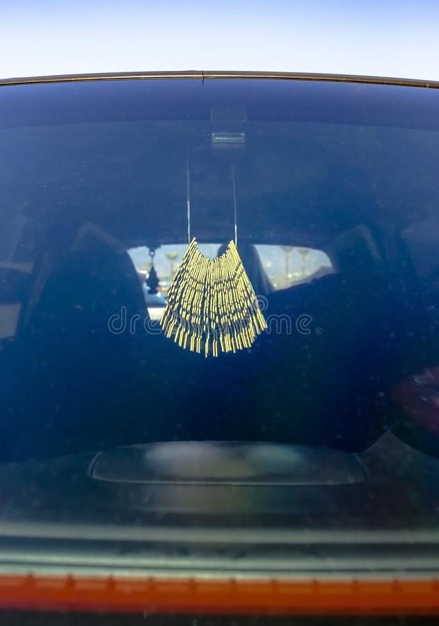 Air freshener hanging in the car on the rear view mirror. Custom cars in Southern California summer 2017 royalty free stock photography