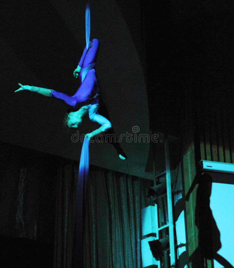 Air gymnast. Young talented trapeze artist on belts, a participant of the concert of folk art collective of children's and youth circus Ale-up festival royalty free stock photography