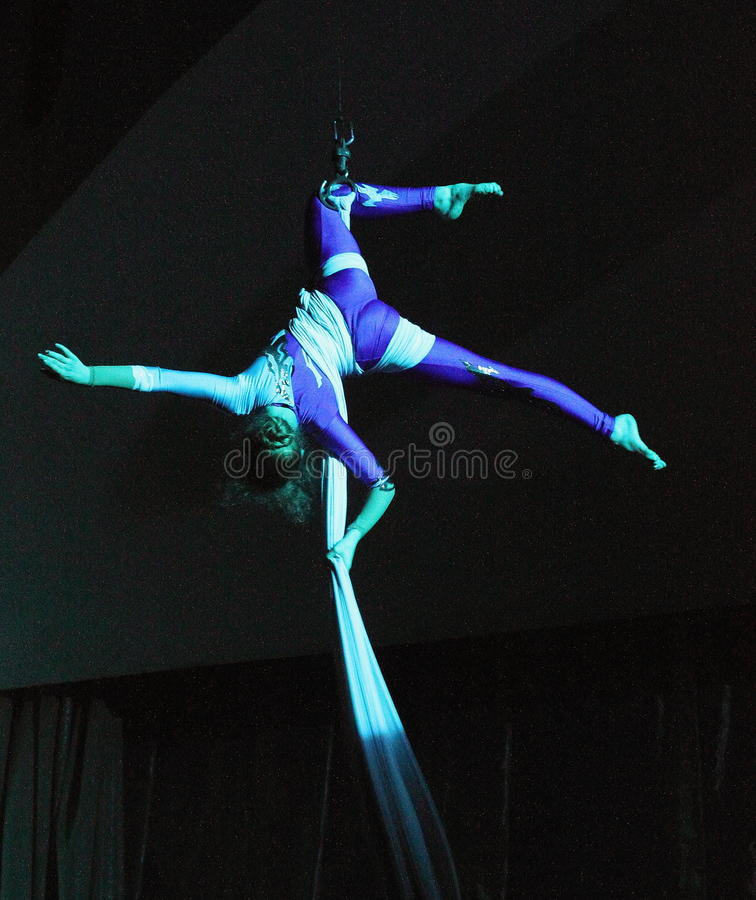 Air gymnast. Young talented trapeze artist on belts, a participant of the concert of folk art collective of children's and youth circus Ale-up festival royalty free stock image